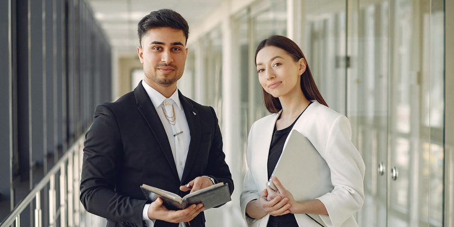 Handsome man in a black suit. Businessman working in a office. Woman with her partner.