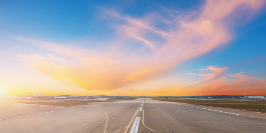 empty-runway-evening-airport-during-sunset_165577-197