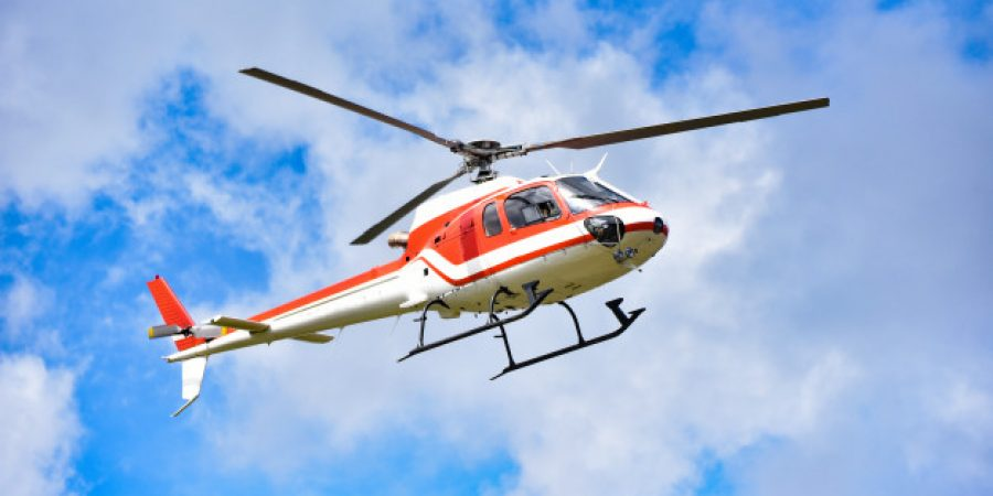 helicopter-rescue-helicopter-flying-sky-white-red-fly-helicopter-blue-sky-with-clouds-good-air-bright-day_73523-110