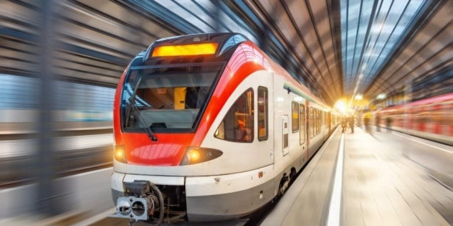 passenger-high-speed-train-with-motion-blur-station_165577-59